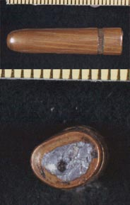 Views of side and base of Commission Exhibit 399. The nick in the base was caused by the FBI when removing lead for testing. The bullet is squeezed but otherwise undamaged.