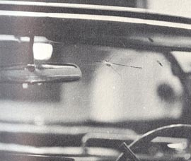 Figure 30. Lead on inner surface and cracks on outer surface of windshield