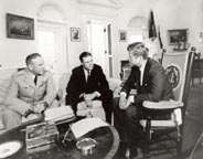 President Kennedy meeting with Secretary of Defense McNamara and General Taylor in October 1963 after their fact-finding mission to Vietnam.