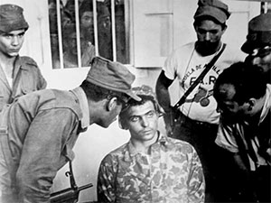 Interrogation of a captured Bay of Pigs invader by Cuban militia