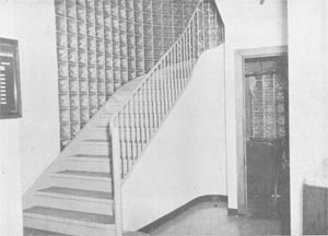 The stairway between the first and second floors near the front entrance of the Book Depository