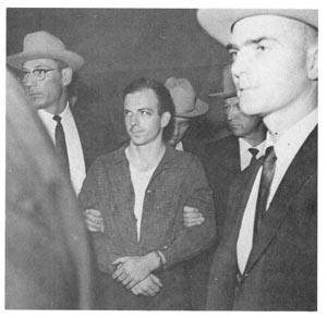 Oswald in custody of Dallas Police