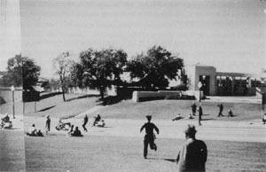 Photo taken by Wilma Bond, depicting officers McLain and Courson on Elm Street in front of the grassy knoll
