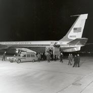 Casket being unloaded into hearse from Air Force One, at Andrews Air Force Base on the evening of 22 Nov 1963.
