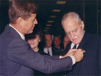President Kennedy pinning a medal on outgoing CIA Director Allen Dulles.
