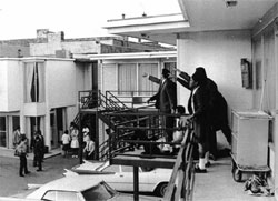Aides on Lorraine Motel balcony with the stricken Dr. King.