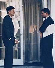 John and Robert Kennedy in discussion outside the White House, 28 Mar 1963