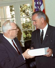 Earl Warren handing the completed Warren Report to President Johnson, 24 Sep 1964. Photo by Cecil Stoughton.